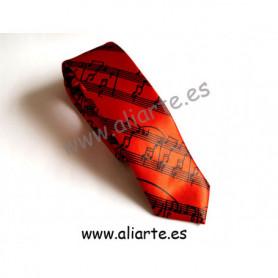 Corbata roja con motivos musicales